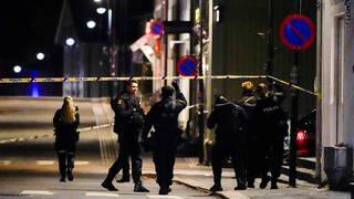 Police officers cordon off the scene in Kongsberg