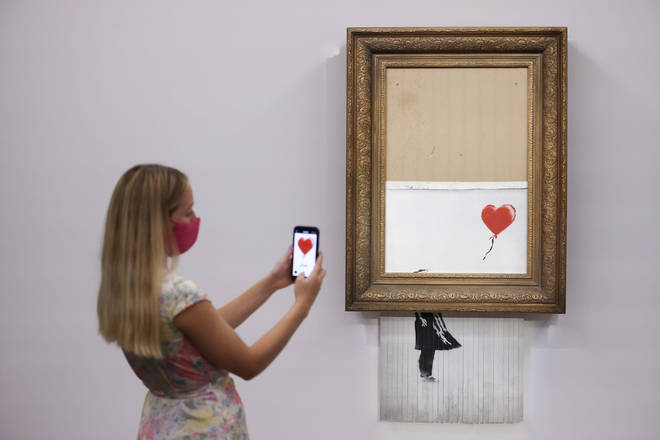 Banksy's Love Is In The Bin sold for over £18m