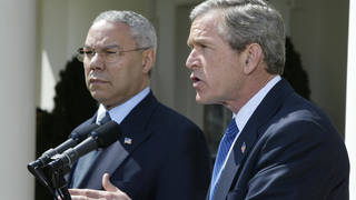 George W Bush pictured with Colin Powell in 2002