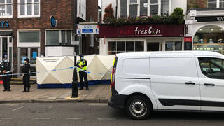 Police at the scene after the fatal stabbing in Hampshire