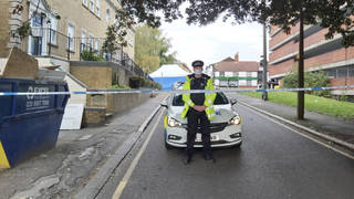Police at the scene where two teenagers died in Essex