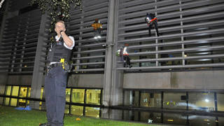 Animal Rebellion campaigners have scaled the front of a government building