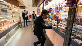 Rishi Sunak at a sweet shop during a visit to Bury Market in Lancashire