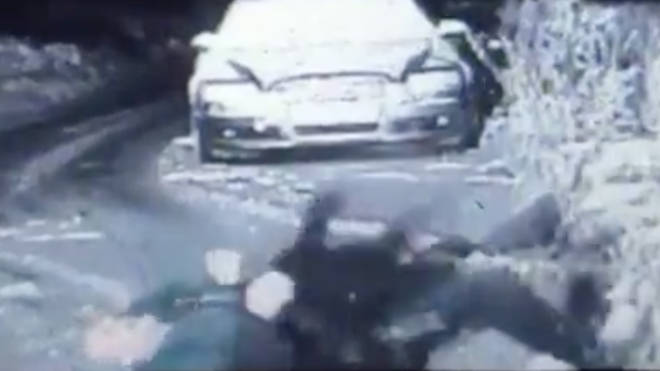 The officer laughs after falling over