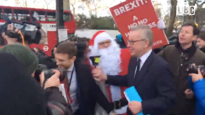 Santa Claus interrupted Michael Gove outside Parliament