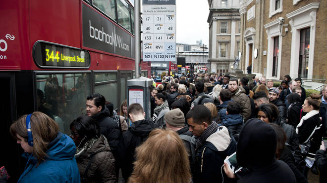 Crowds of commuters struggle to catch buses during a tube strike