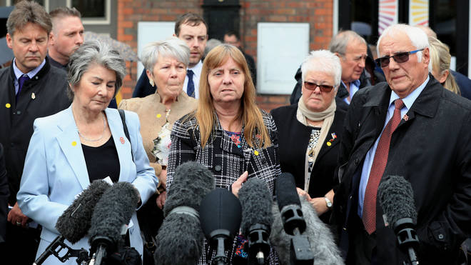 Margaret Aspinall (centre) speaks to the media outside Parr Hall, Warrington, where the CPS said Hillsborough match commander David Duckenfield had been charged with offences relating to the Hillsborough disaster Photo: PA