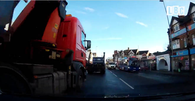 Lorry almost crashes into merging car