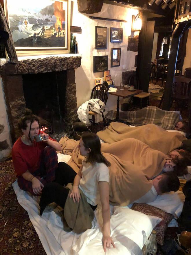 People sleep in the bar at the Jamaica Inn