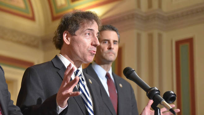 Jamie Raskin (left) is the author of the bill, which aims to make use of the 25th amendment and oust Trump Photo: PA