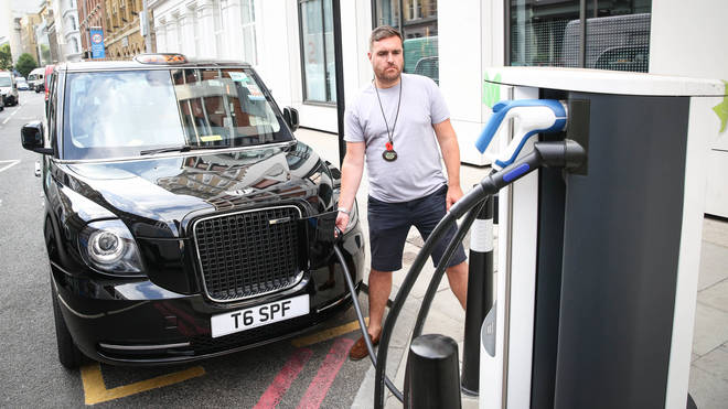 A cabbie charges his black cab at one of the few charging points in central London