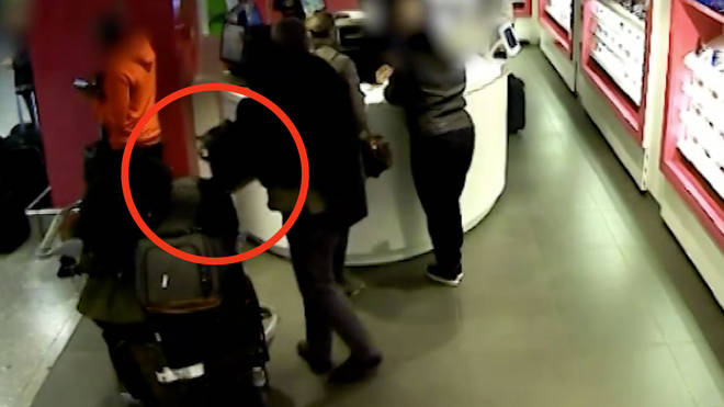 The brazen bag snatch was caught on CCTV inside Heathrow Airport