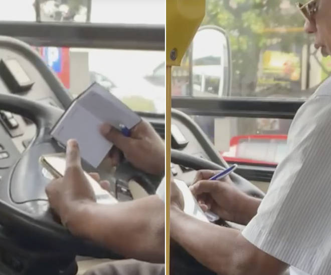 A bus driver was caught taking notes from a phone call whilst driving a packed bus