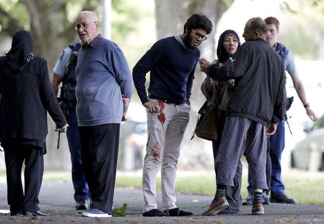Survivors from the Mosque shooting with blood on their clothes