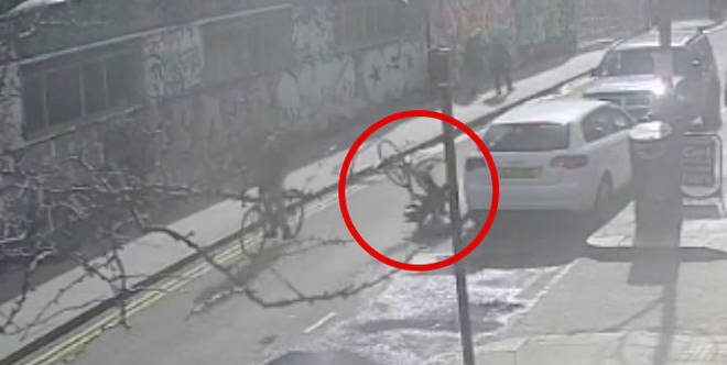 Police hunting man who kicked a cyclist off his bike