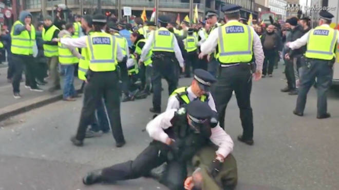 Met Police Medic seen seeming to punch a protester