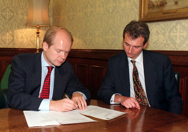 David Lidington sits with Conservative leader William Hague in 1997