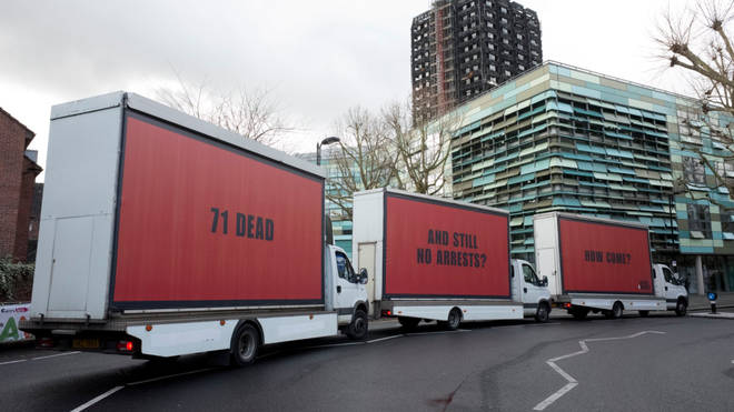 Three billboards appeared outside Grenfell Tower on Thursday