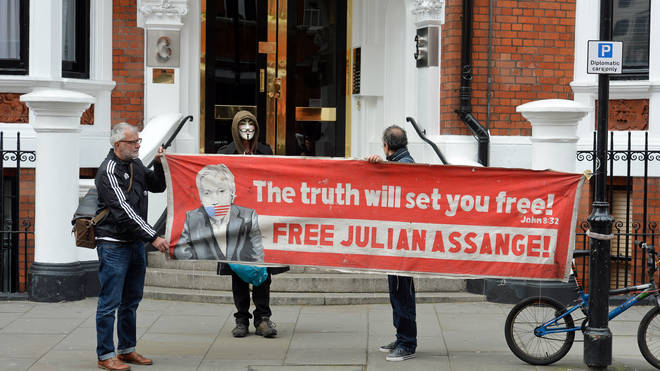 Supporters of Julian Assange protest outside the Ecuadorian embassy amid rumors the WikiLeaks founder is to be expelled