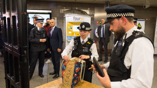 Home Secretary Sajid Javid and Metropolitan Police Deputy Commissioner Steve House observing a bag search at Angel underground station