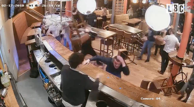 Bar stools and glasses were thrown in the shocking incident