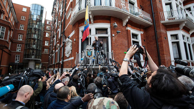 Julian Assange speaking in 2017 from the balcony of the Ecuadorian embassy in London
