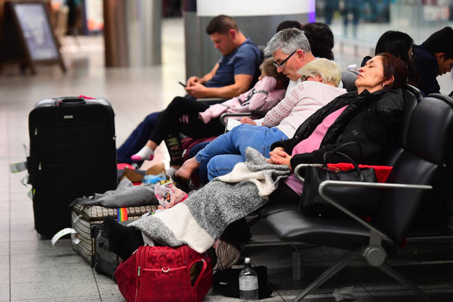 Passengers sleeping at Gatwick airport which was closed for several days following drone sightings over the airfield.