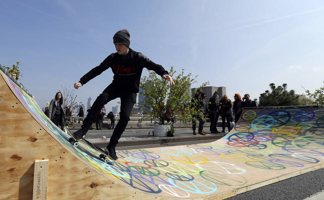 Climate change protesters turned Waterloo Bridge into a skate park on Monday
