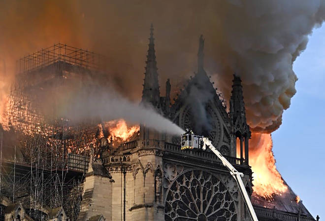 Firefighters tackle the blaze as Notre Dame cathedral burns
