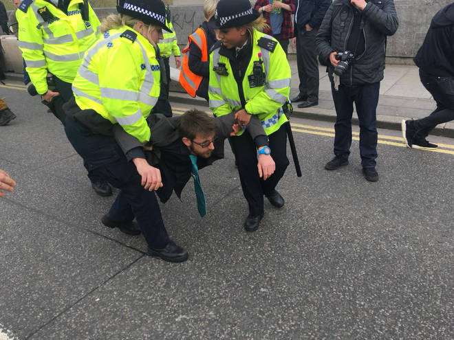 Police carried some protesters off Waterloo Bridge