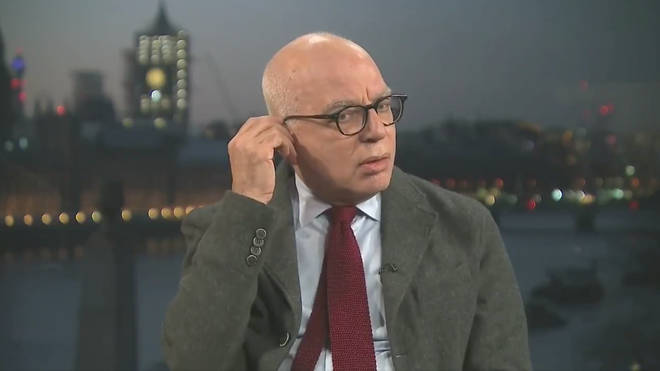 Michael Wolff fiddles with his earpiece