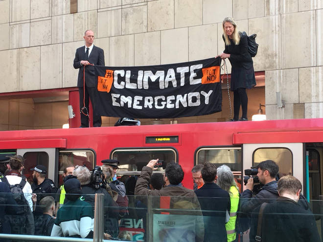 Protesters on top of a DLR train at Canary Wharf