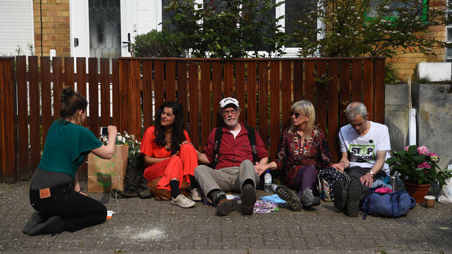 Four protesters have glued themselves to Jeremy Corbyn's house