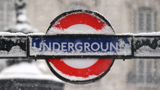 London Underground sign covered in snow