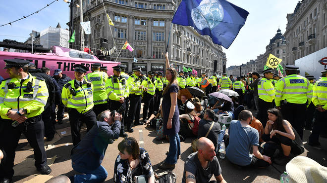 Police officers at Oxford Circus amongst the Extinction Rebellion protesters
