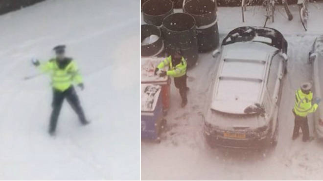 Police officers having a snowball fight