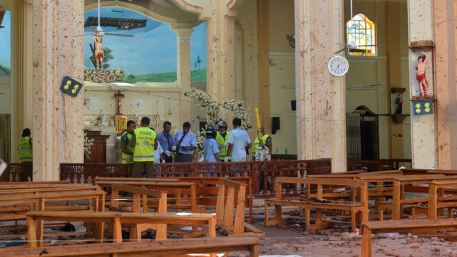 Investigators among the debris in St Sebastian's Church in Negombo