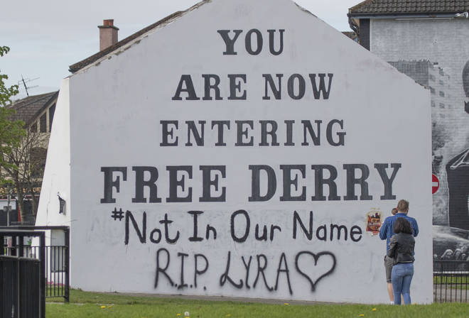 A message of condolence for 29-year-old journalist Lyra McKee which has been graffittied on to the Free Derry Corner.