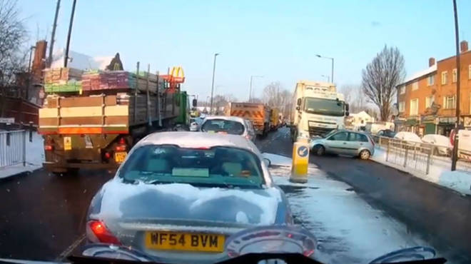 Lorry driver unknowingly pushes car 250ft down snowy road