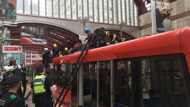 Five protesters were arrested at the DLR this morning