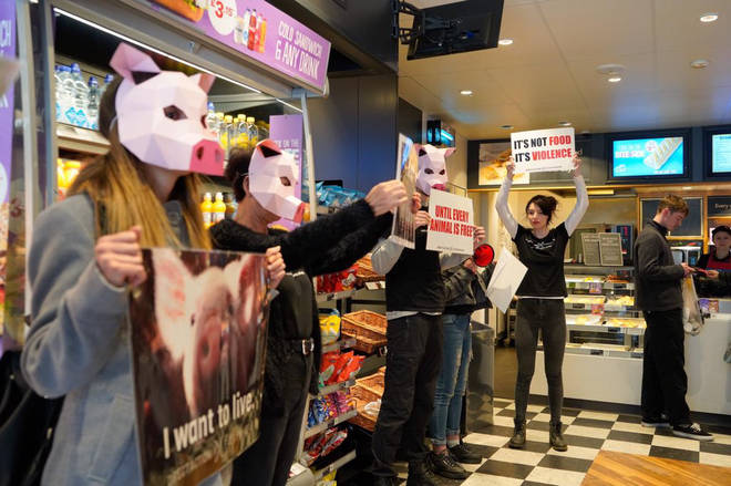 Vegan activists protesting in Brighton's Greggs.