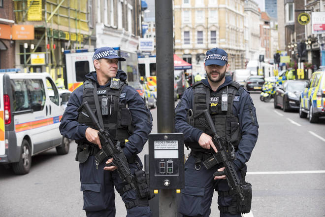 Armed police guard the crime scene in the aftermath of the attacks on London Bridge and Borough Market.