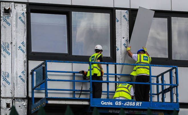 Cladding is removed from Whitebeam Court, in Pendleton, Greater Manchester.