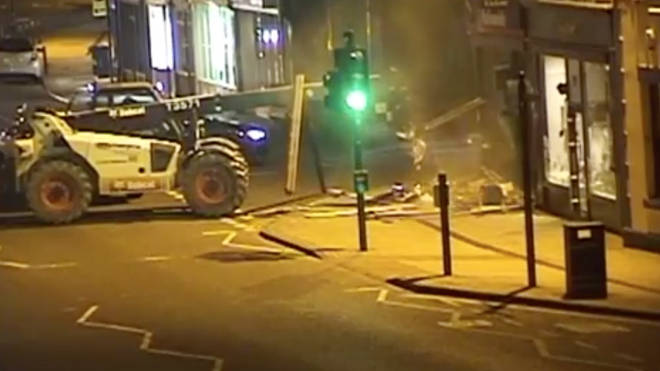 Thieves used a Bobcat telehandler to rip a cash machine from a Nationwide branch