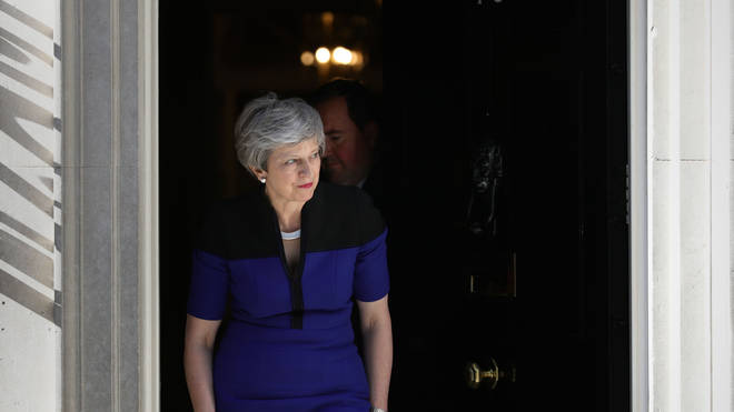 Theresa May coming out of Downing Street