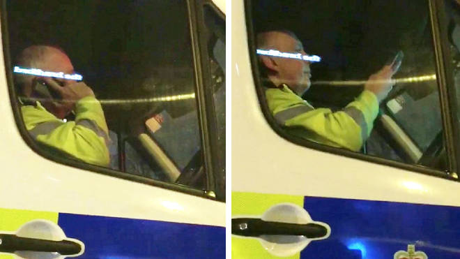 Video appears to show the police officer making a call while behind the wheel