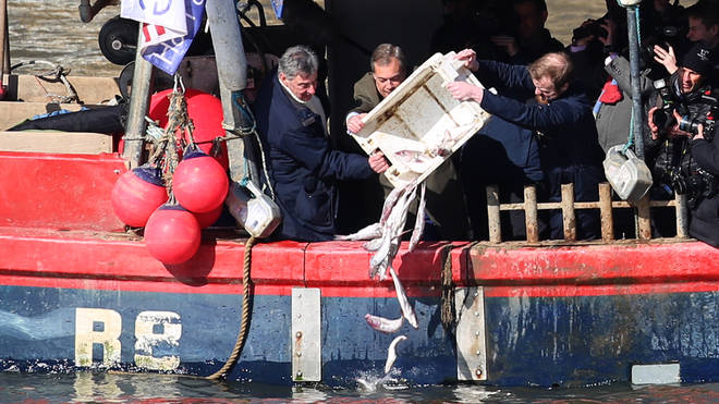Nigel Farage tips fish into the River Thames