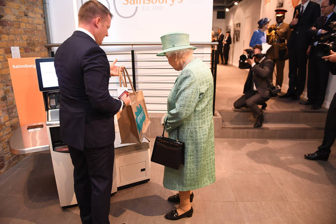 The Queen was shown how to use a self-service checkout.