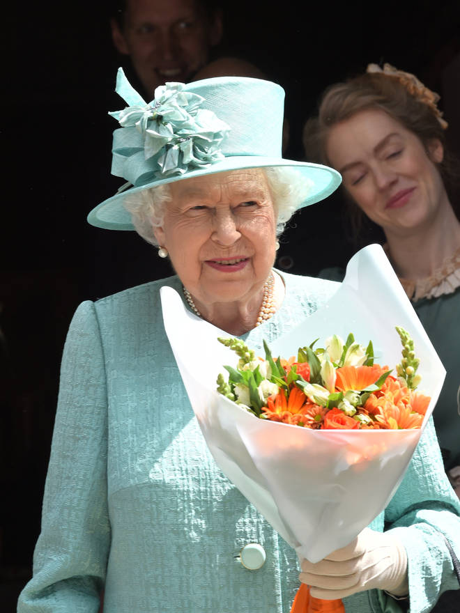 The Queen was presented with a bouquet of flowers.