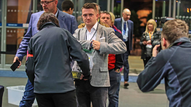 Tommy Robinson goes through security at the count